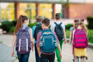 group-kids-going-school-together_109285-2833